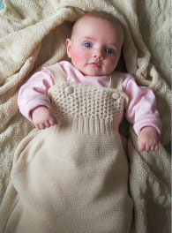 Baby in Disana's knitted organic Merino wool sleeping bag