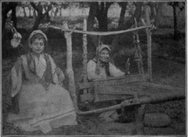 primitive-loom-and-a-girl-spinning-wool